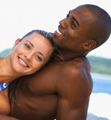 Young Affectionate Couple Relaxing on Beach